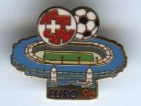 [Swiss badge]